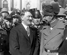 Outside the church, a bemused Chancellor Hitler chats with the Kaiser's son and heir, Crown Prince Wilhelm - c.March 1933