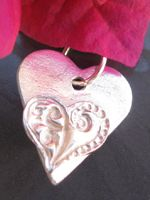 http://www.aromapendants.com.au/products/002-14-$44.00-1.8cm.jpg. Made by Julie Primmer