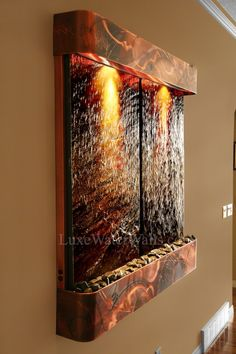 an indoor wall fountain is a great art idea for any wall in the home