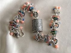 Anne Choi Sugar Skull Boro Lampwork Coral Lapis Bracelet, The skilver skull and the wire work on this is great!