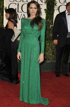 In her signature long-sleeved style, Angelina Jolie shined in an emerald green Atelier Versace gown that was encrusted with Swarovski crystals at the 2011 Golden Globes. #redcarpet101