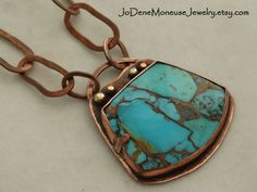 Kingman Turquoise with bronze veining, set in a hand fabricated copper bezel with 14k gold filled accents, on a handmade, chunky copper chain $135.00  by JoDeneMoneuseJewelry
