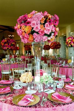 Bright pink and orange wedding flower centerpiece, photo by Yvette Roman Photography
