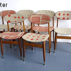 Mid-century modern chairs recovered with fun fabric.