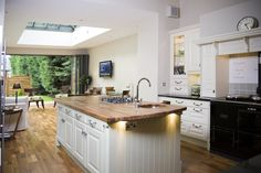 https://flic.kr/p/czPUGf | Period Extension | The interior of this period kitchen extensions shows off excellently Apropos' ability to flood your home with, not only extra space, but also just how much natural light can find its way into your home; saving on energy bills and improving emotional well-being.  This has been done through both a set of folding sliding doors to accessorize   the orangery extension to the back but also a beautiful roof lantern opens the room up to outside light…
