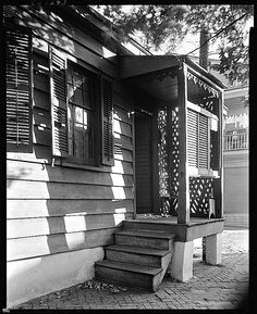 The Sunday porch/enclos*ure: Savannah. The lattice and panel of shutters may indicate an old bordello. ca. 1939, by F.B. Johnston, via Library of Congress