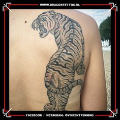 Black and grey Tiger backpiece tattoo. Designed and Tattooed by: Vincent Penning Dragon Tattoo. Backpiece Tattoo, Tattoo Portfolio, Black And Grey, Dragon, Tattoos, Design, Tatuajes, Tattoo