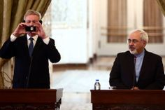 Behrouz Mehri/AFP/Getty Images SNAPSHOT: Sweden's Foreign Minister Carl Bildt, left, took pictures with his mobile phone as Iranian Foreign Minister Mohammad Javad Zarif watched during their joint press conference in Tehran Tuesday. Mr. Bildt is on an official visit to Iran to try to bolster the country's temporary nuclear deal.