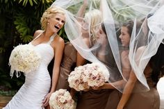 Gorgeous shot of the bride and her bridesmaids under the veil.