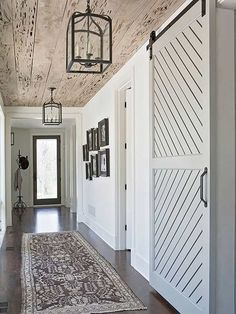 Create a stylish entryway by following these four steps: 1. Bold Accents, 2. Go Rustic, 3. Add A Barn Door and 4. Create A Kid Zone.