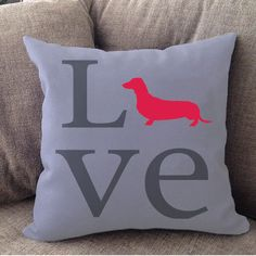 "Our super soft Dachshund Love pillow is 16"""" x 16"""" in size with zipper cover. Printed on both sides. Made in USA. Spot clean."
