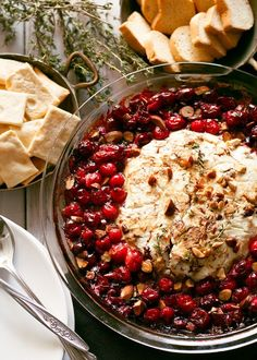 Baked Goat Cheese Roasted Cranberry Appetizer - This baked goat cheese roasted cranberry appetizer recipe is easier to make than it looks! It is the perfect appetizer for holiday gatherings like Thanksgiving and Christmas!