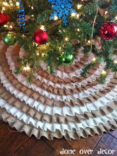"""Burlap ruffled tree skirt with NO SEWING involved!!  Use an old tree skirt, cut burlap into 2"""" thick strips, and start glue gunning!  Definitely wanna make one for this year with red, green, and white!!"""