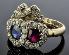 Barely! A Victorian 18ct gold mounted sapphire, ruby and diamond Luckenbooth dress ring, the two intertwined central hearts individually set with a Ceylon sapphire and a ruby -The Canterbury Auction