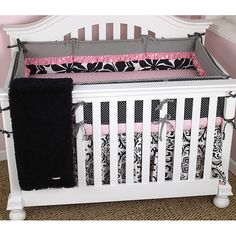 Create a cute and girly nursery for your little princess with this adorable crib bedding set for girls. It has a pink, white, and black color scheme, and it comes with everything you need to adorn her crib, so she'll sleep surrounded by softness.