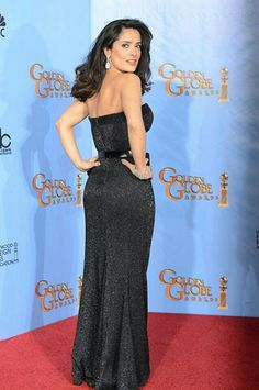 Salma Hayek showing off her booty in a floor length gown