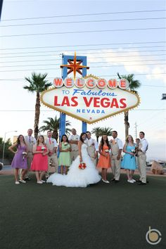 A fun group shot in front of the Las Vegas Sign Las Vegas Sign, Las Vegas Nevada, Fun Group