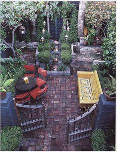 Brick patio, lanterns, yellow glider, vintage gates...