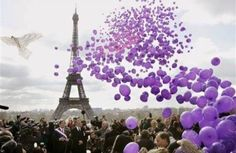 Eiffel Tower and a sea of lavender balloons.