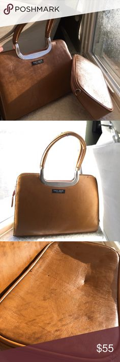 Kate spade handbag | 2 for 1 Kate spade handbag comes with another small bag that can be used as a wallet or your makeup. Handles are a bit worn as shown in photos. Make up bag has some imperfections on one side. Both bags clean from the inside. Additional photos upon request. kate spade Bags Mini Bags