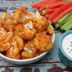 """Buffalo Cauliflower   """"This is a great substitution for buffalo wings! Can be made gluten-free, vegan, or vegetarian. Make sure to coat your cookie sheet well with oil or they will stick. Husband and kids give this two thumbs up! Dip this in ranch or blue cheese for even more added flavor, but it doesn't need it."""""""""""