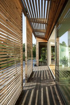 Outdoor rooms are the latest craze, what about outdoor hallways. Great idea and … Outdoor rooms are the latest craze, what about outdoor hallways. Great idea and provides shade to house. Architecture Details, Interior Architecture, Exterior Design, Interior And Exterior, Wall Exterior, Exterior Shutters, Outdoor Shutters, Breezeway, Wood Slats