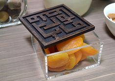 Ghina Acrylic Box - Beautiful geometric Kufic spells out 'alghina fil nafes', an Arabic saying that means 'richness in spirit'. Use this box for storing wrapped sweets or even your personal keepsakes, visible through the clear acrylic base!