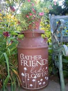Old Milk Can...re-purposed & painted & used as a plant stand in the garden.   http://fleamarketgardening.org/