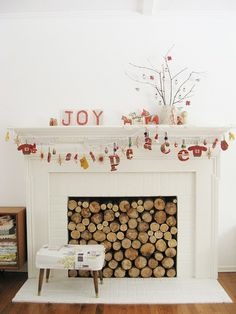 18-exquisite-christmas-mantels; Attach wood slices to a back panel for a cool look~d