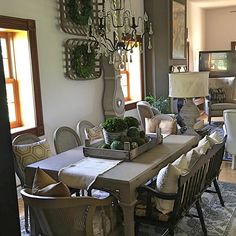 PaintedFoxHome.com Wreaths, Clock, Chandelier, Centerpiece Ingredients & Tobacco Baskets, along with so many other details in this shot, can be found at Painted Fox Home! Wall Color is Sherwin Williams Eider White. Table and Chairs are Annie Sloane Cocoa. Rug is from Wayfair.