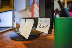 """This short, life-changing Catholic prayer, """"Your will, Lord,"""" is featured on a sticky note on this author's desktop computer."""