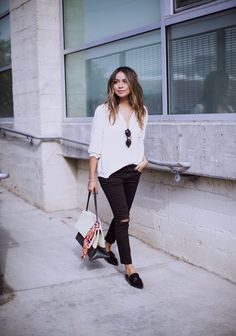 Julie Sarinana looks utterly sophisticated in this monochrome style centred around a pair of sleek black loafers. These shoes are the perfect match to this loose fitting blouse and black slacks, creating a gorgeous overall look! Brands not specified.