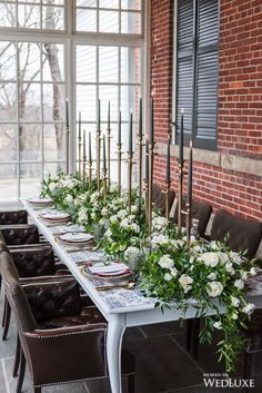 High and Low | Low flower arrangements were surrounded by tall towering candles…