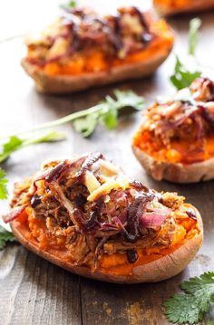 BBQ Chicken Twice Baked Sweet Potatoes - Recipe Runner - Creamy sweet potatoes baked twice and topped with BBQ chicken, caramelized onions, and smoked gouda cheese!