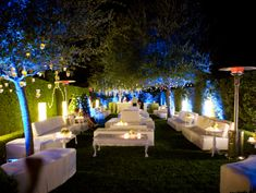 Create an outdoor lounge for cocktail hour. Make it interesting with the use of colored lighting.