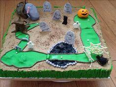 18 x 24 Halloween themed golf hole cake, pumpkin, spider, web, golf ball, tombstone, water hazard tar pit, Frankenstein hand, coffin, spooky tree, ghost, cat, fondant figures, brown sugar sand
