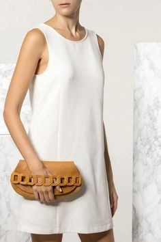 Carry your essentials in style with the Iro design clutch. This boho-chic piece is handmade of fine quality leather, features our signature chain handle and it comes in 5 colors: Camel/brown (waxed tan), black, black & white, nude (nubuck), blue (nubuck). Greek Chic Handmades bags are handcrafted in Athens, Greece. Shop your favorite leather bag to accompany your handmade sandals. Most importantly we use the same premium leather we built the sandals with and the impeccable local… White Clutch Bags, Leather Clutch Bags, Handmade Clutch, Leather Bags Handmade, Leather Craft, Athens Greece, Black White, Essentials, Women's Accessories