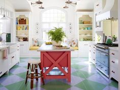 The custom island in this eclectic kitchen is painted rich coral to match the ceramic knobs and pulls. See more of this home from HGTV Magazine. Beautiful Kitchens, Kitchen Colors, Eclectic Kitchen, Kitchen Remodel, Kitchen Decor, Cottage Kitchen, Home Kitchens, Shabby Chic Furniture, Kitchen Design
