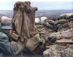 "German forward observation post somewhere on the Eastern Front. Note the ""scissor glasses"" wrapped with burlap as camouflage. The observer keeps some hand grenades handy (right front)."