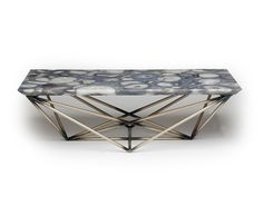 Intricately welded steel tube base with distressed bronze finish. Top is a unique gray agate stone slab with reversed bevel edges.
