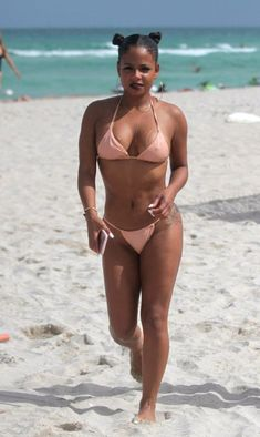 EVERYONE would love to see black R&B singer Christina Milian nude. Today is your lucky day, boys. Christina Millian, Bikini Beach, Miami Beach, Carne, Bikinis, Swimwear, Naked, Singer, Celebrities