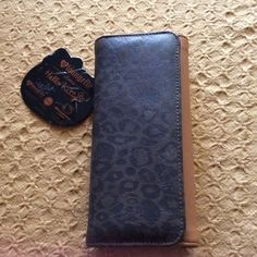 Loungefly wallet NWT.   WEEKEND SALE Hello Kitty adult wallet.   Cute animal print and tan faux leather. Hello Kitty Bags Wallets