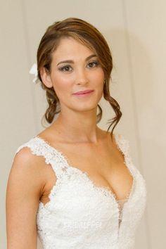 Elegant v neckline sleeveless open back spring wedding dress with lace detail.