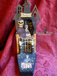 Pretty sure I would not open that gate - ever. Hand-painted and distressed, this coffin shaped wooden shrine is decorated with creepy papers, skulls, dead witches, black lace and metal embellishments.