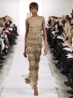 Fall 2014 LOOK 40 Gold bead and lacquered feather embroidered tiered tulle gown