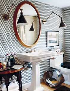 Deborah Needleman's bathroom, via Domino I love the lights and wallpaper. Lights are so unexpected