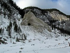 The Cave and hoodoos beyond Grotto Canyon near Canmore, Alberta, Canada
