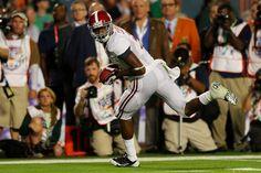 MIAMI GARDENS FL - JANUARY 07:  Amari Cooper #9 AlabamCrimsTide runs with ball his way scoring touchdown third quarter