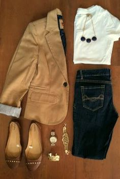 tan blazer with dark jeans; Personally, I'd replace the blazer with a trench coat or a duster.