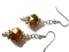 Hey, I found this really awesome Etsy listing at http://www.etsy.com/listing/159721312/champagne-pearl-earrings-bronze-earrings